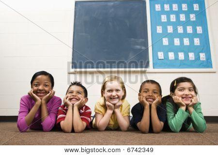 Students Lying On Floor In Classroom.