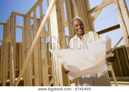 Man Holding Building Plans