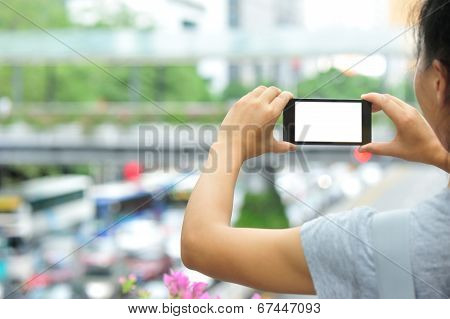 woman hands hold smart phone in modern city poster