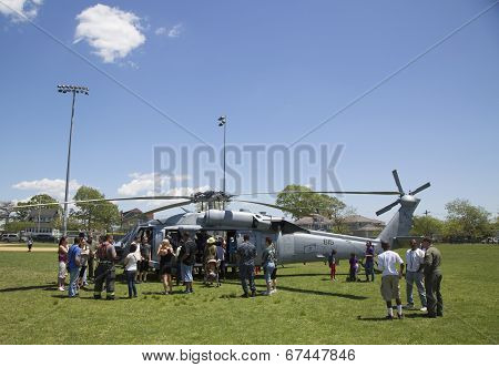 Numerous spectators around MH-60S helicopter from Helicopter Sea Combat Squadron Five during Fleet W
