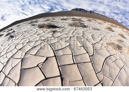 Cracked clay crust is vast desert - takyr. California, USA. Photo taken fisheye lens