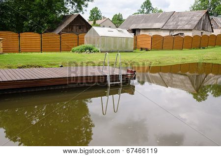 Garden Pond With Floating Footbridge
