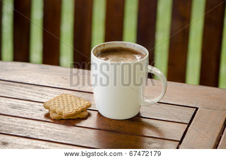 Cup Of Hot Coffee In White Cup And Cookie Biscuit