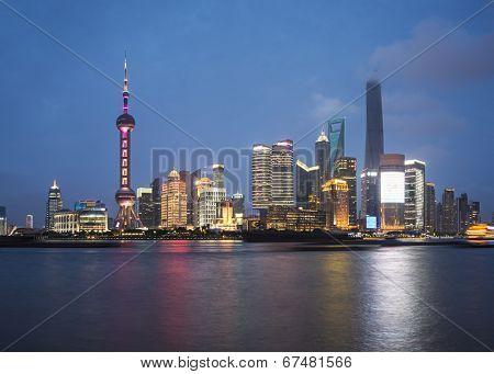 Shanghai, China skyline across the Huangpu River.