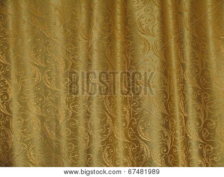 Golden texture of fabric with the waves