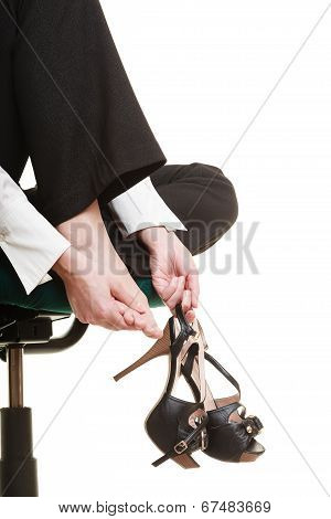 Work stoppage and leg pain. Closeup of tired businesswoman woman sitting on chair and massaging feet isolated on white. poster