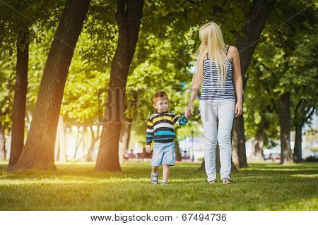 Mother with son in the park
