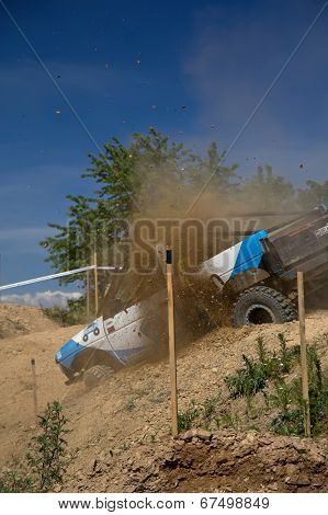 Off Road Car Is Trying To Get Out Of Difficult Terrain