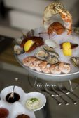 Fresh catch of the day - a coastal seafood platter piled high with lobster shrimp clams and oysters on ice poster