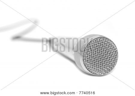 Silver Microphone Placed On A White Background