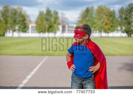 Superhero Standing With Hands On Hips And Looking Sideways