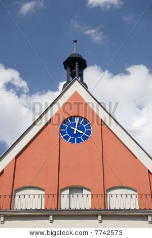 city hall clock - housetop in front of blue sky poster
