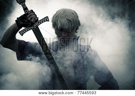 brutal warrior with sword in smoke