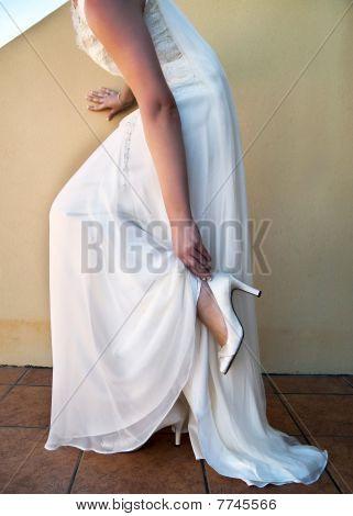 Bride Adjusting Shoe