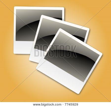 Photo frames on shiny background.