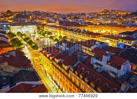 Rossio Square at night and Maria II Theatre. View from Santa Just elevador. Lisbon, Portugal