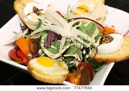 Delicious salad on white bowl