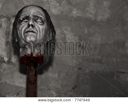 Decapitated head lying on wooden stake after medieval Inquisition execution poster