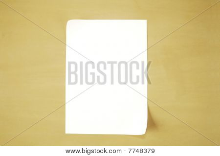 A piece of paper on a wood background