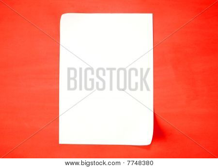 A piece of paper on a red background