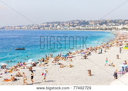 Tourists in the beach in Nice, France