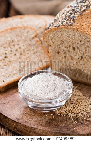 Homemade loaf of bread on dark wooden background poster