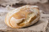 Some homemade Buns (close-up shot) on rustic wooden background poster