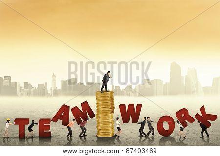 Businesspeople Create A Teamwork Text