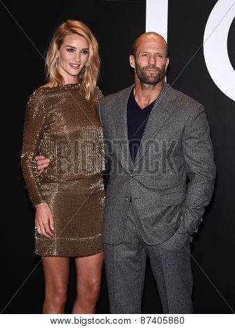 LOS ANGELES - FEB 20:  Rosie Huntington-Whiteley & Jason Statham arrives to the Tom Ford Autumn/Winter 2015 Womenswear Collection Presentation  on February 20, 2015 in Hollywood, CA