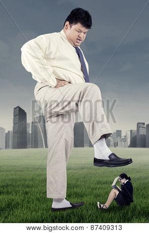 Worker Trampled By Businessman With His Foot