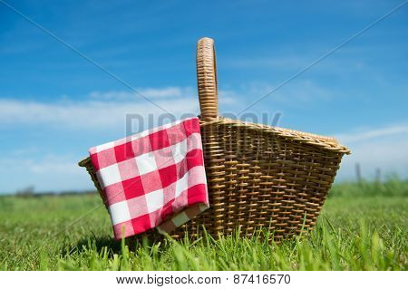 Picnic basket in grass outdoor