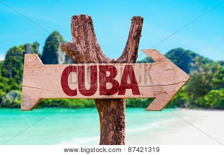 Cuba wooden sign with beach background