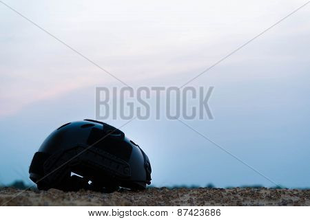 Modern combat helmet in the darkness.