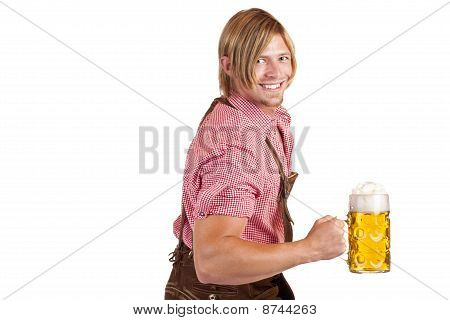 Bavarian man shows biceps muscles and holds oktoberfest beer stein.