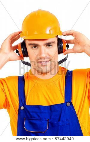 Industrial worker wearing protective helmet and earmuffs. Job, occupation. Isolated over white.