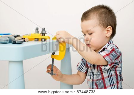 child playing in tools