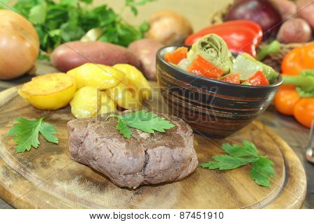 Ostrich Steak With Crispy Baked Potatoes And Vegetables