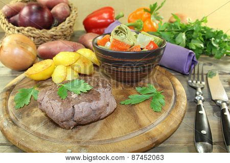 Ostrich Steak With Crispy Baked Potatoes And Parsley