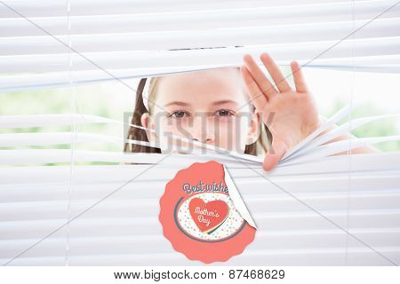 mothers day greeting against little girl peeking through blinds