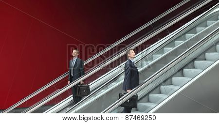 Business Man Going Up And Down Escalators, Concept Of Choice And Success