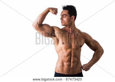 Shirtless Athletic Young Muscle Man Staring at his Biceps