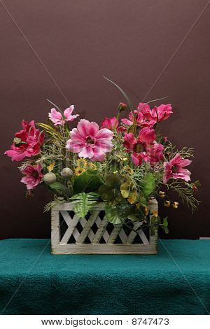 Bunch of flowers in a wooden pot