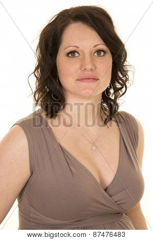 Woman In A Brown Dress Upper Body Looking Serious