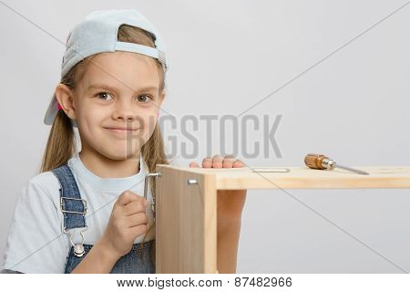 Girl In Overalls Furniture Collector Tries To Tighten The Screw
