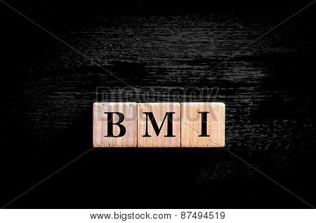 Acronym Bmi - Body Mass Index Isolated On Black Background