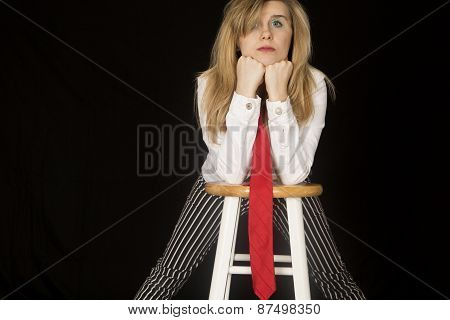 Female Portrait Of Model Leaning On Her Elbows On A Bar Stool
