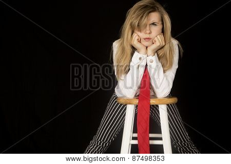 Angry Expression On Female Leaning On Elbows On A Barstool