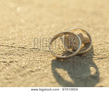 Wedding Rings Put On The Beachside.