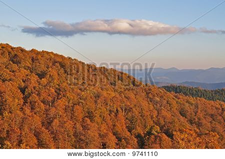 Autumn evening in mountains.