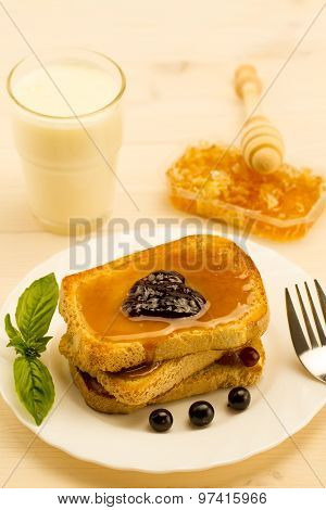 fresh french toast with honey and jam on a white plate with berries. healthy diet poster